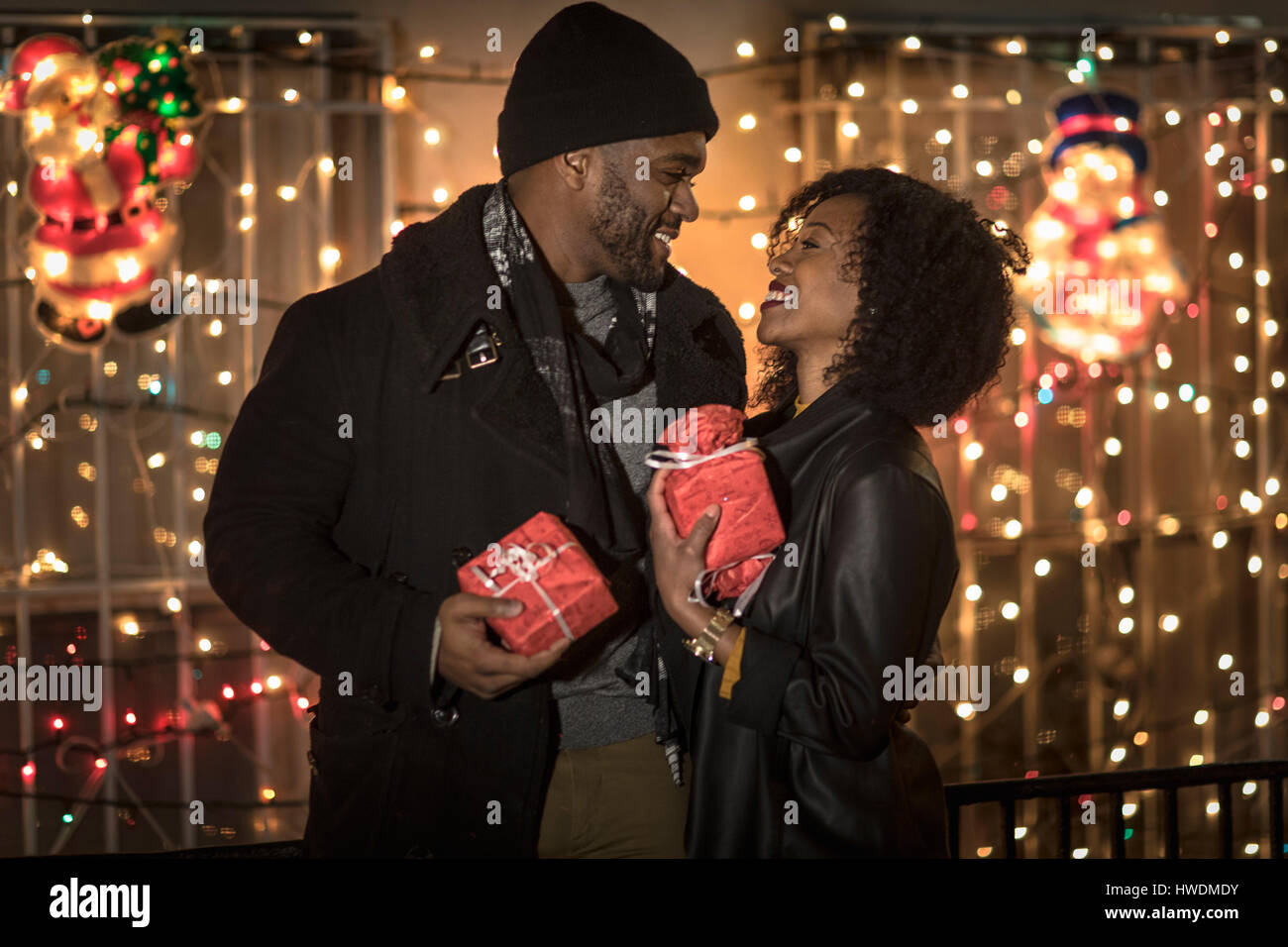 Romantic Couple Exchanging Christmas Gifts At Night New York Usa