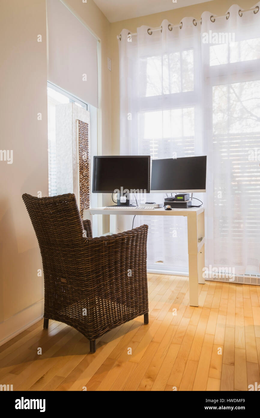 High Back Wicker Chair And Table With Computer In Home