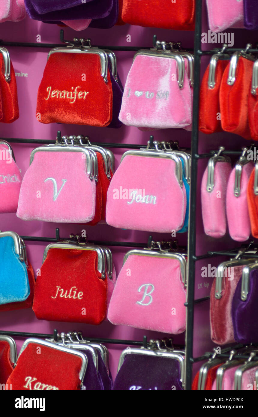 Coloured woman's purses with names or initials. - Stock Image
