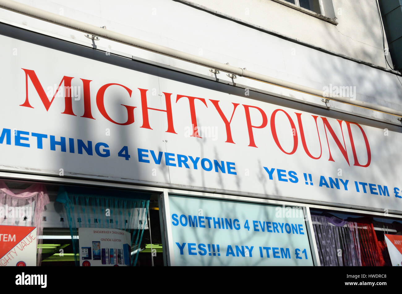 Mighty Pound sign on shop front. Stock Photo