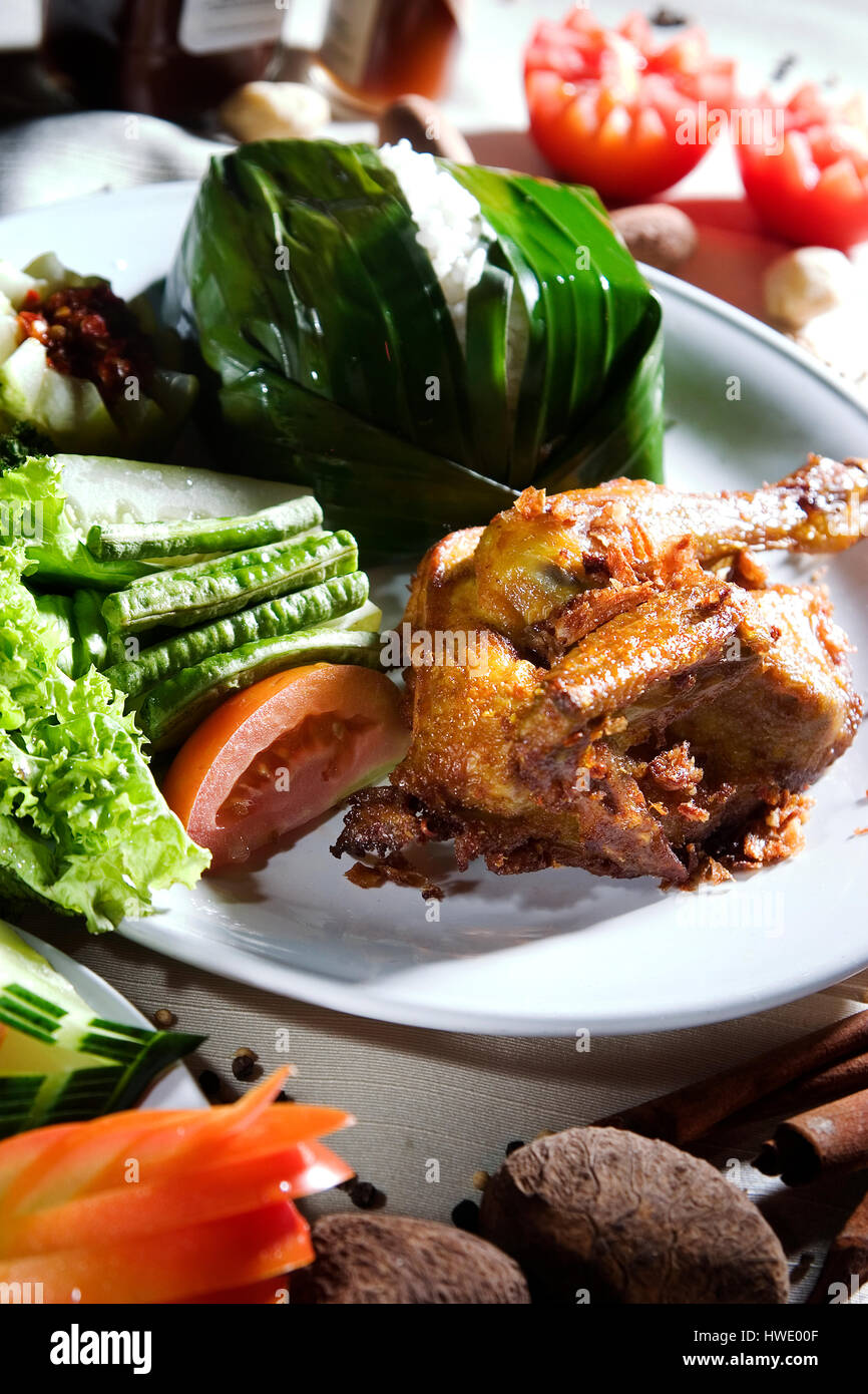 Ayam goreng Fried chicken Food Indonesia, serve with rice - Stock Image