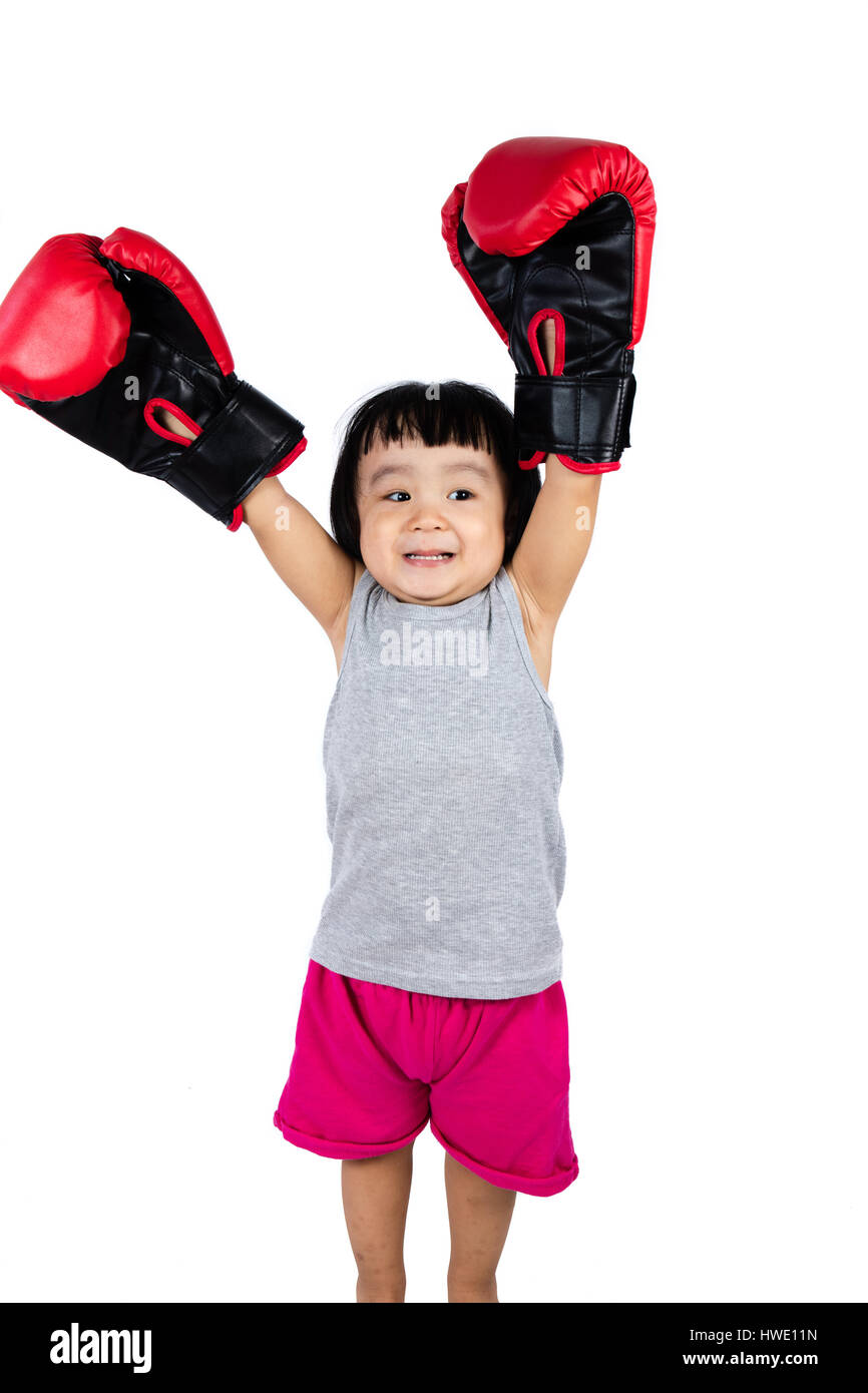 Asian Little Chinese Girl Wearing Boxing Glove with Hands Up