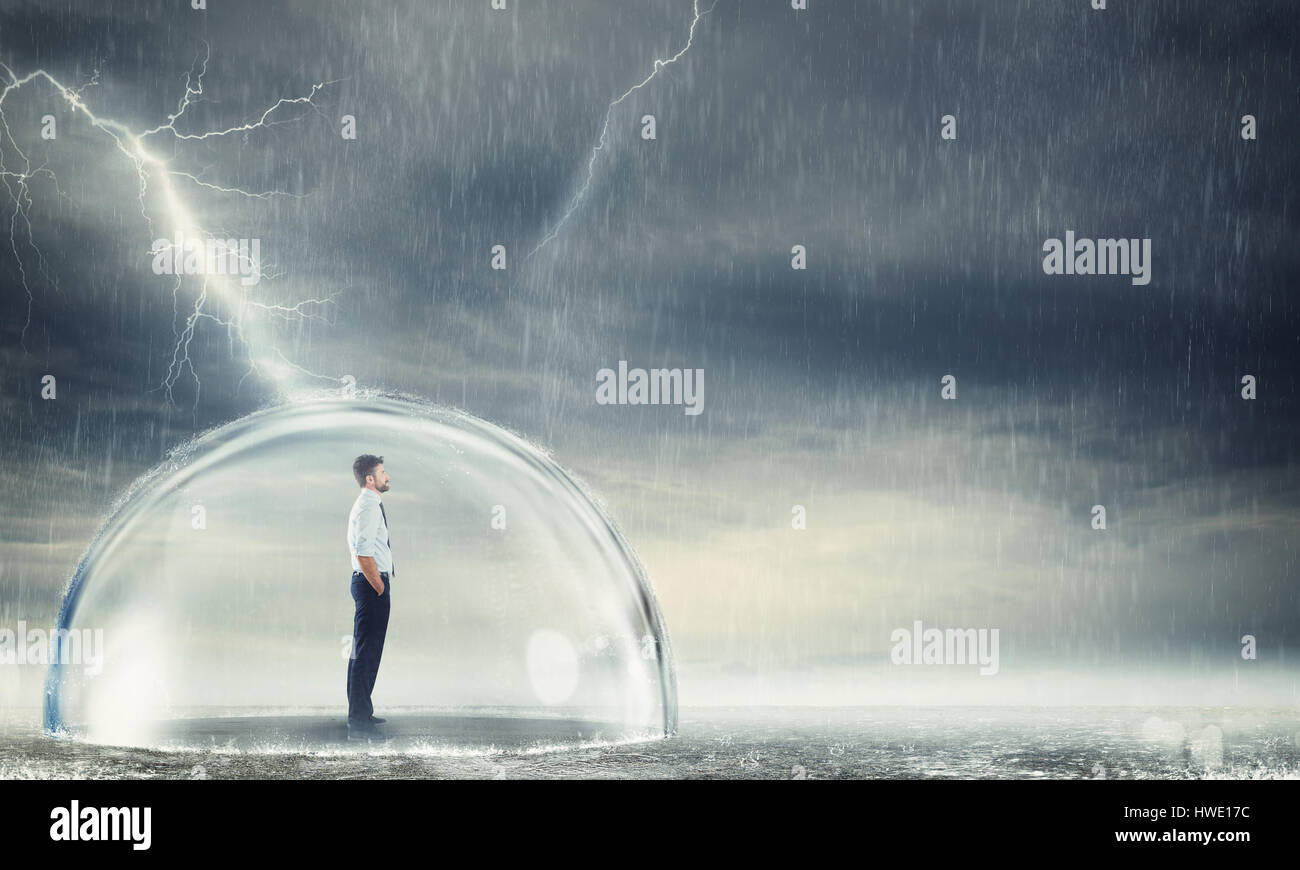 Businessman protected from the crisis - Stock Image