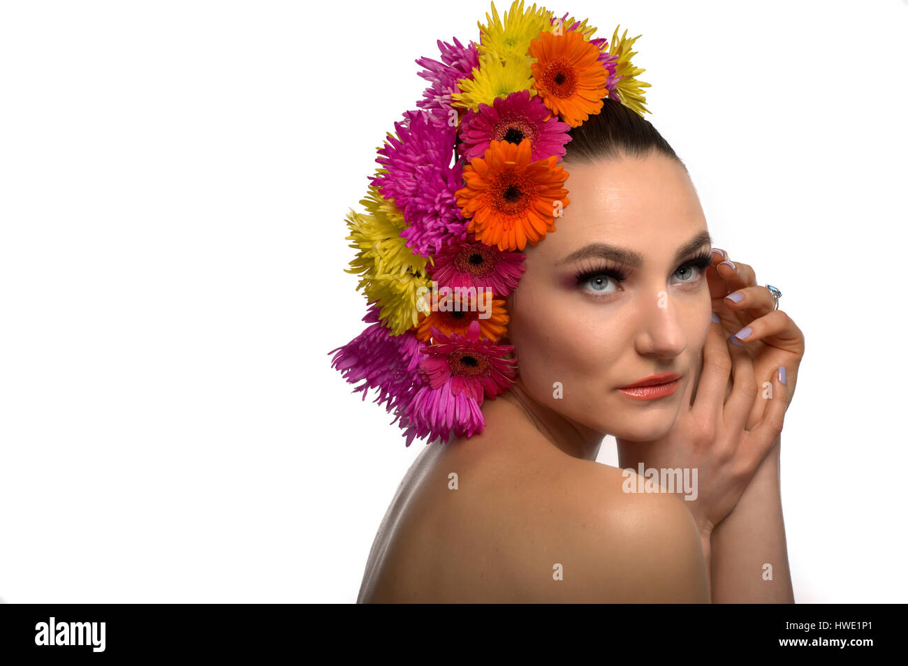 beautiful topless woman with fresh flowers on her head Stock Photo