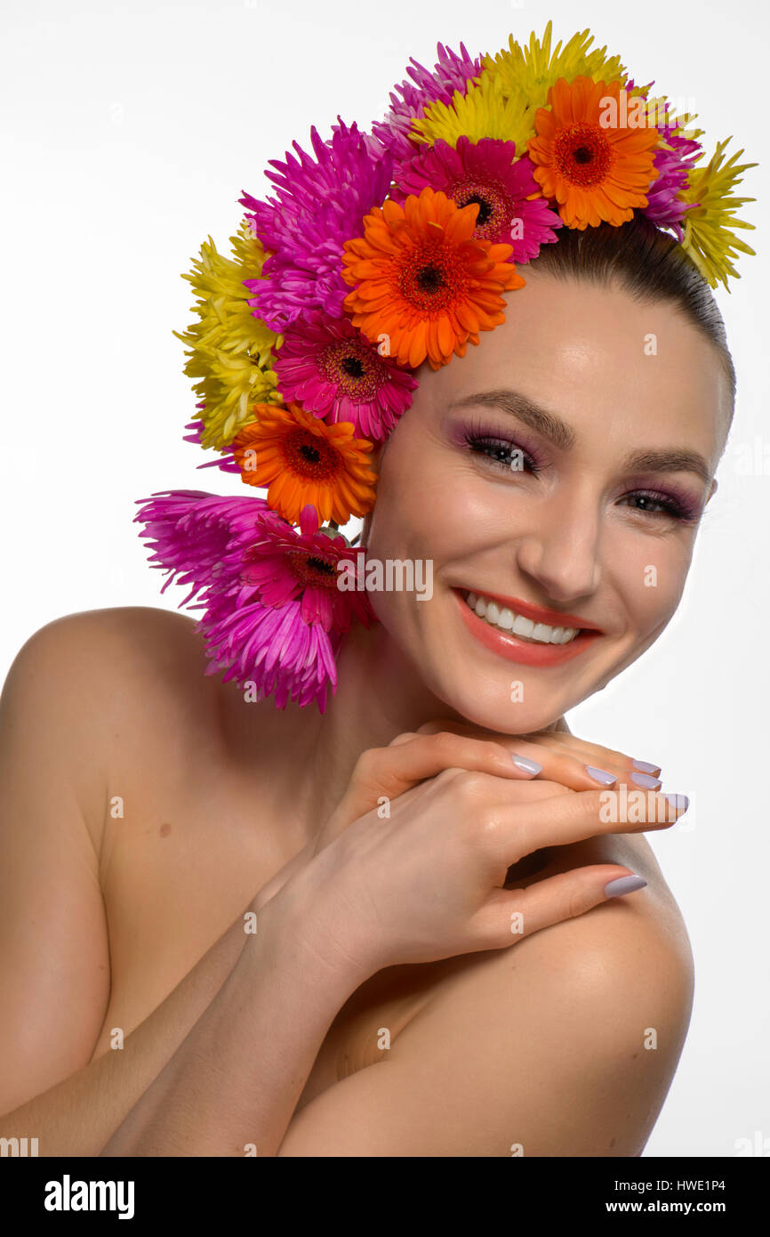 beautiful topless woman with fresh flowers on her head smiling Stock Photo