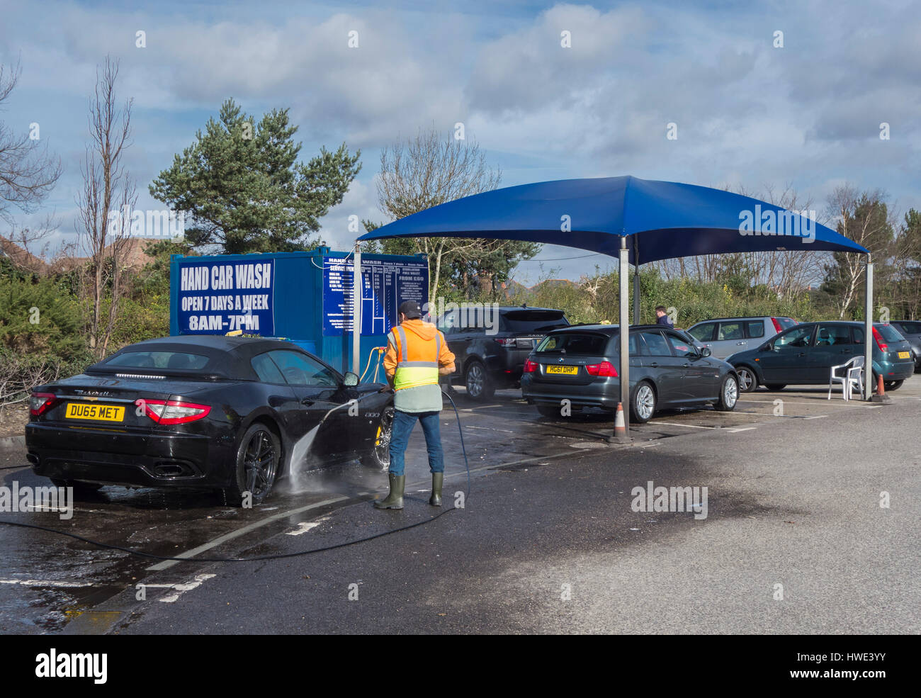 Hand Wash Car Wash >> Cars Being Cleaned At A Hand Car Wash Unit In A Car Park In