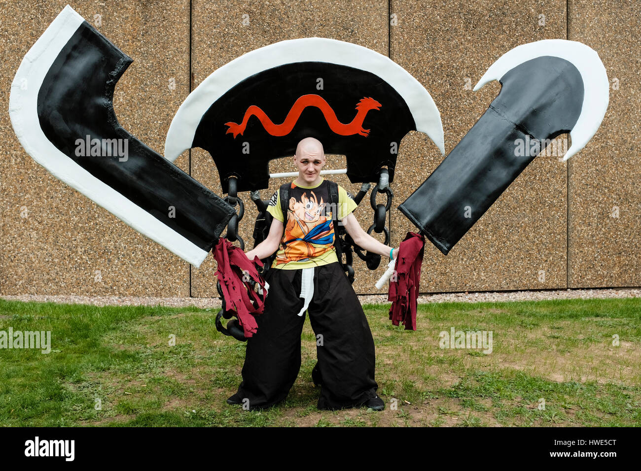 Young man attending MCM Comic Con, Birmingham, UK 2017 in character costume - Stock Image