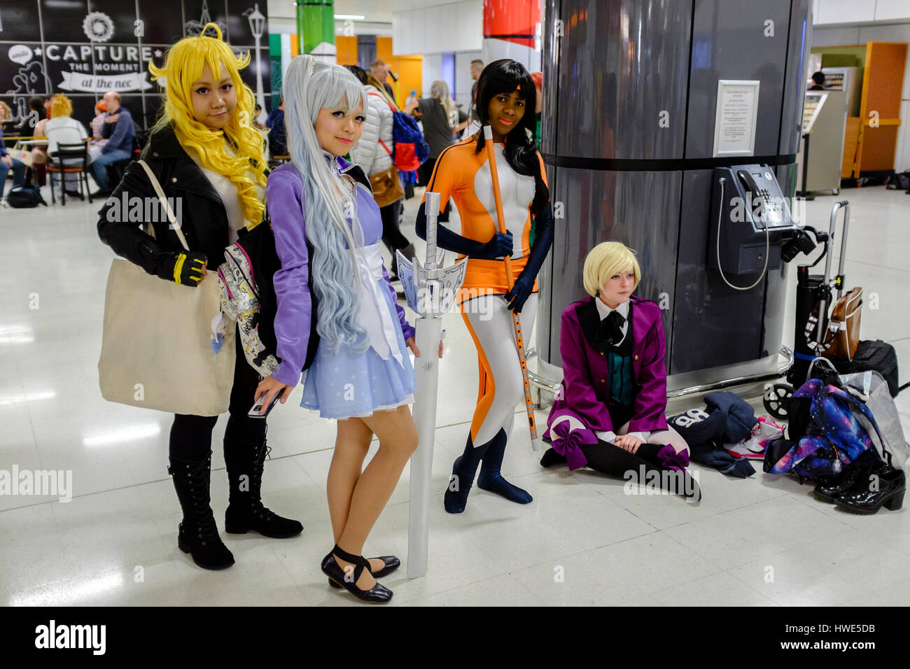 Group of young females in anime costumes attend mcm comic con birmingham uk 2017