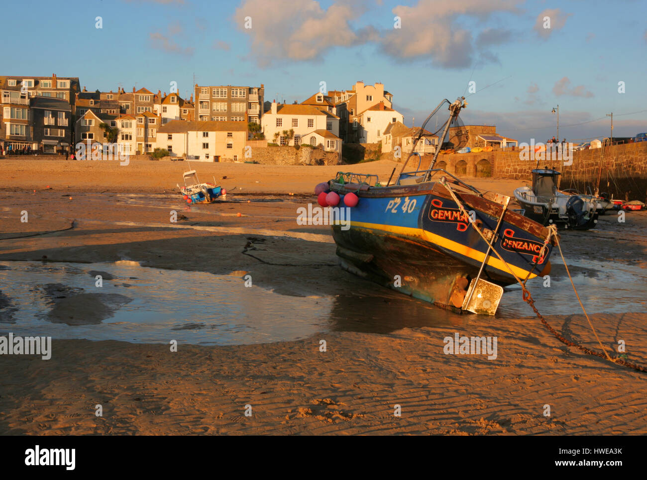 fishing boats at low tide, St Ives harbour, Cornwall, UK Stock Photo