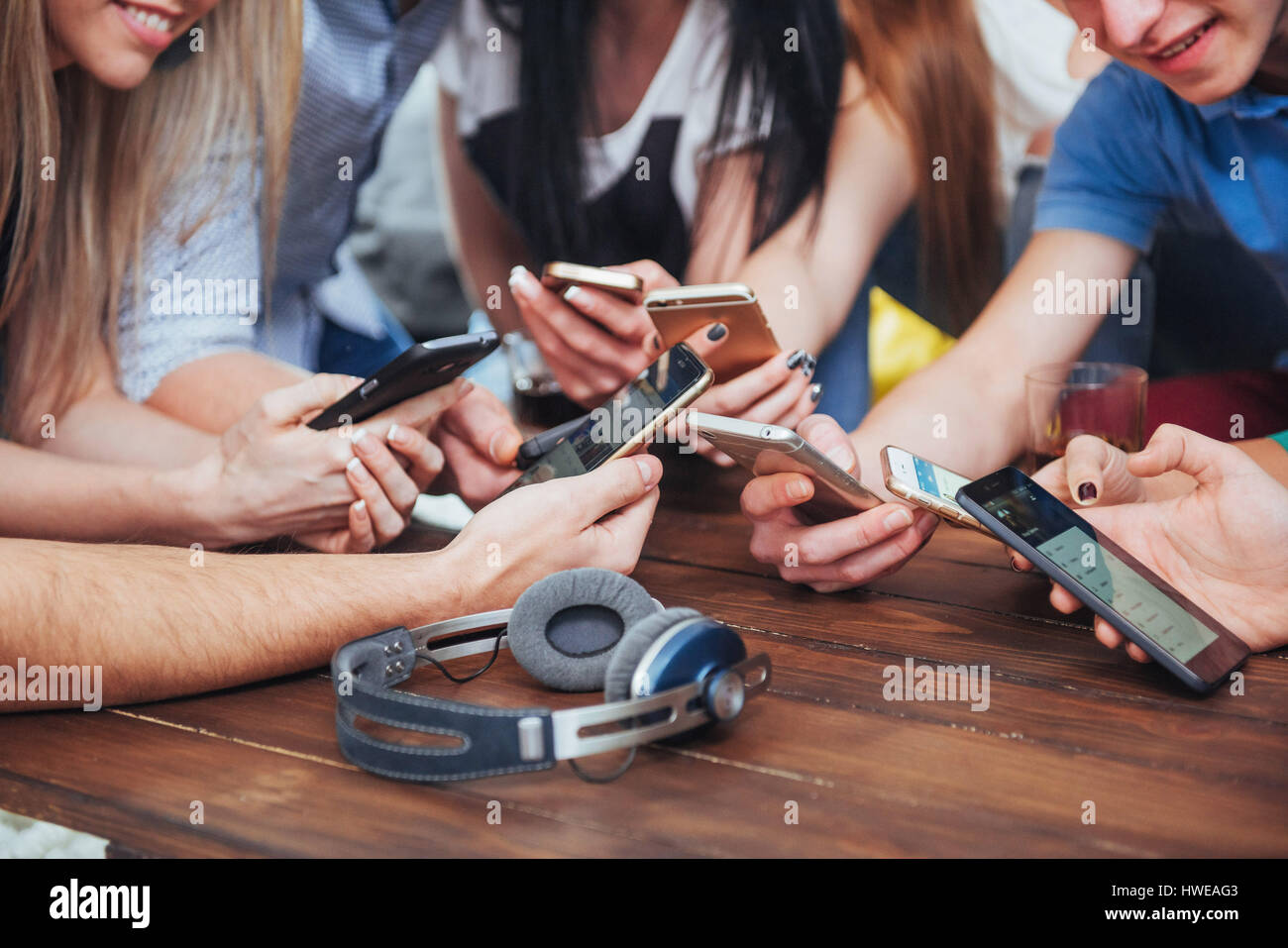 top view hands circle using phone in cafe multiracial friends