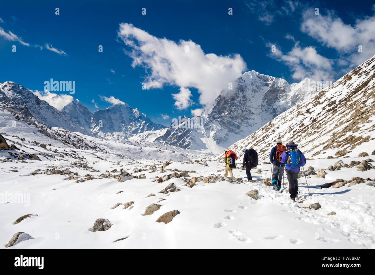 Sagarmatha National Park, Nepal, March 14th 2015. A group of trekkers and sherpas is going back from Everest Base - Stock Image