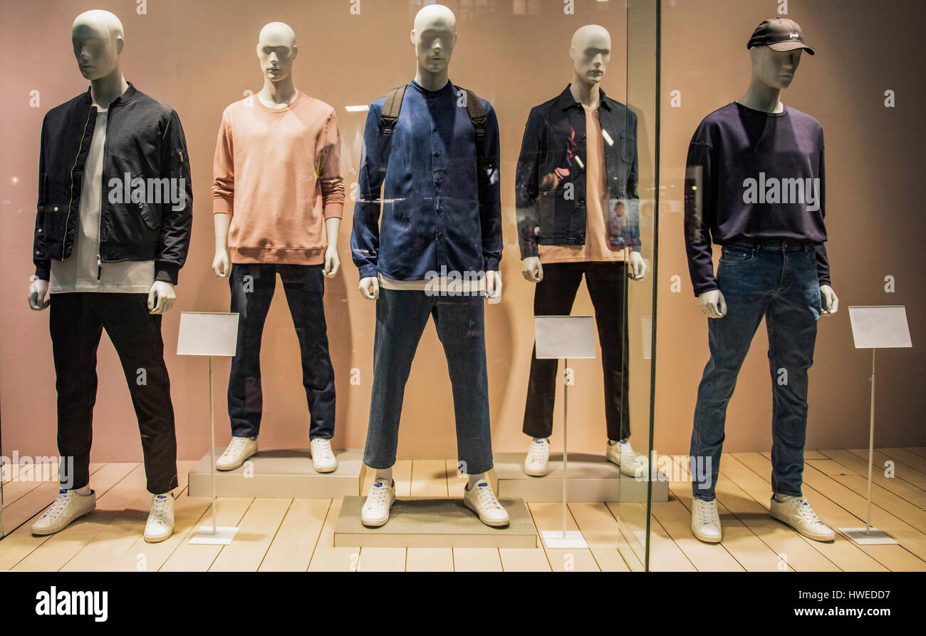 Mens clothing in a casual fashion store - Stock Image