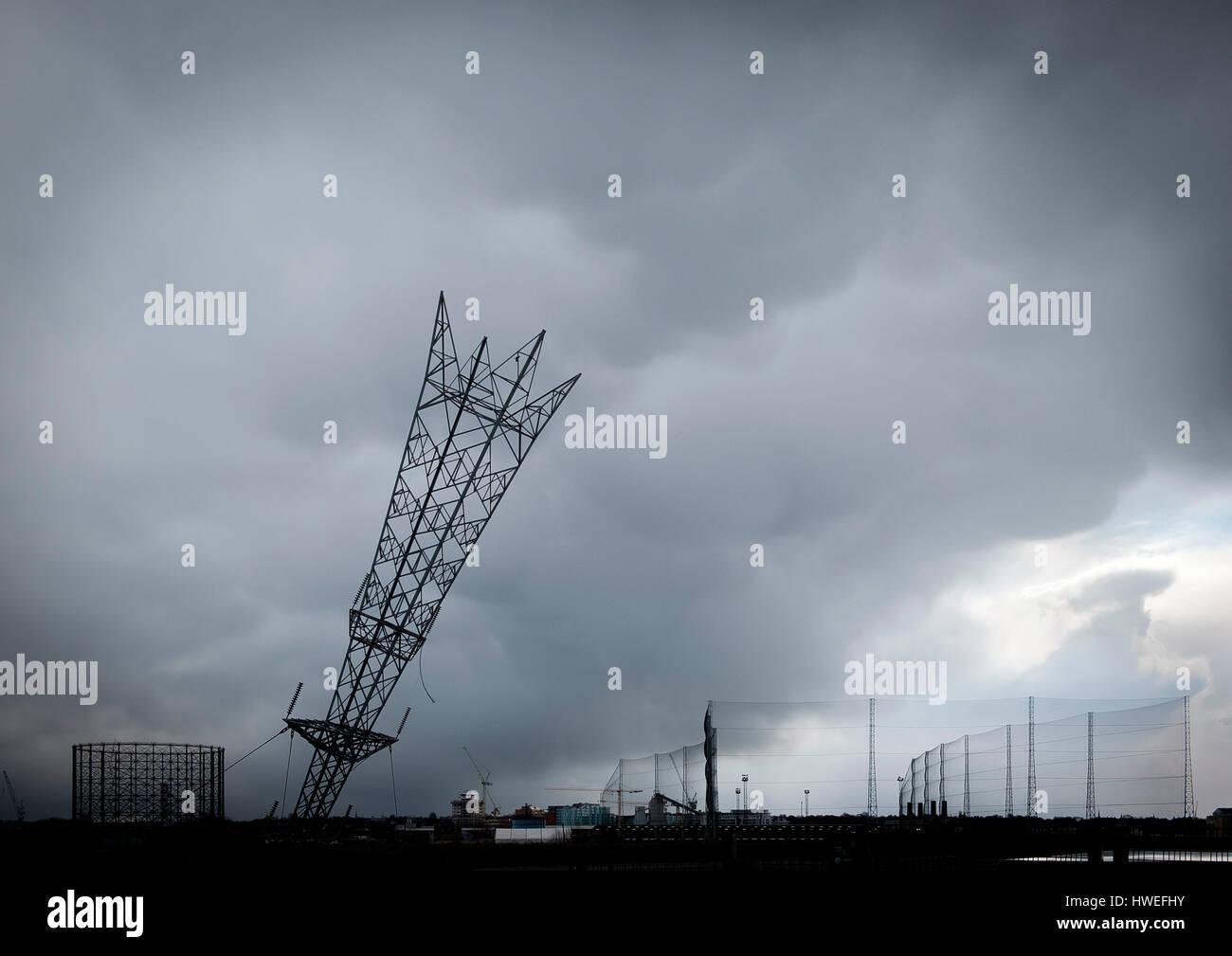 Inverted pylon - installation art by Alex Chinneck, North Greenwich Peninsula, London - Stock Image