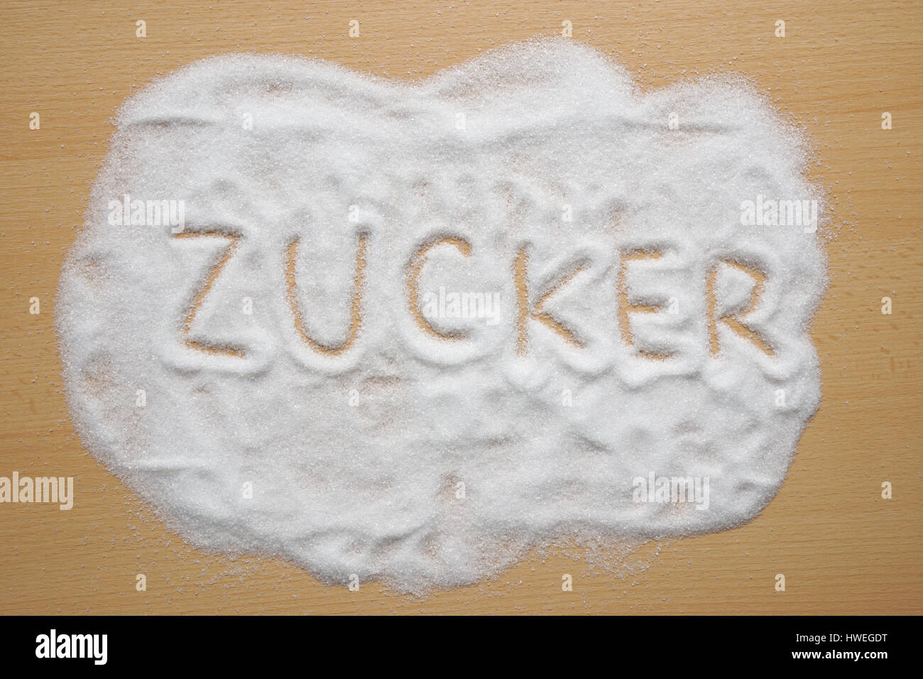 German word Zucker written in sugar - Stock Image