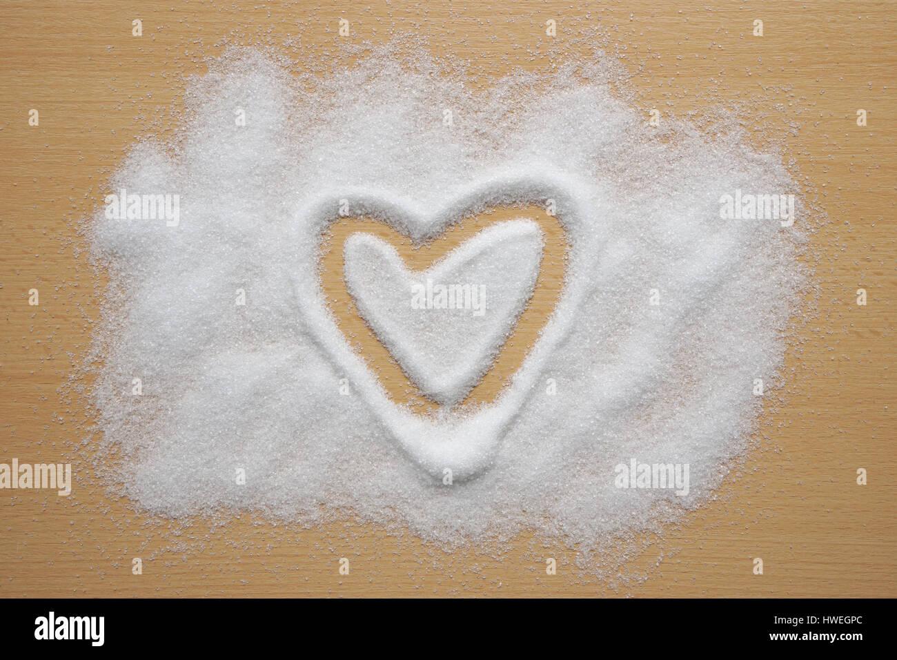 heart shape drawn in sugar - Stock Image