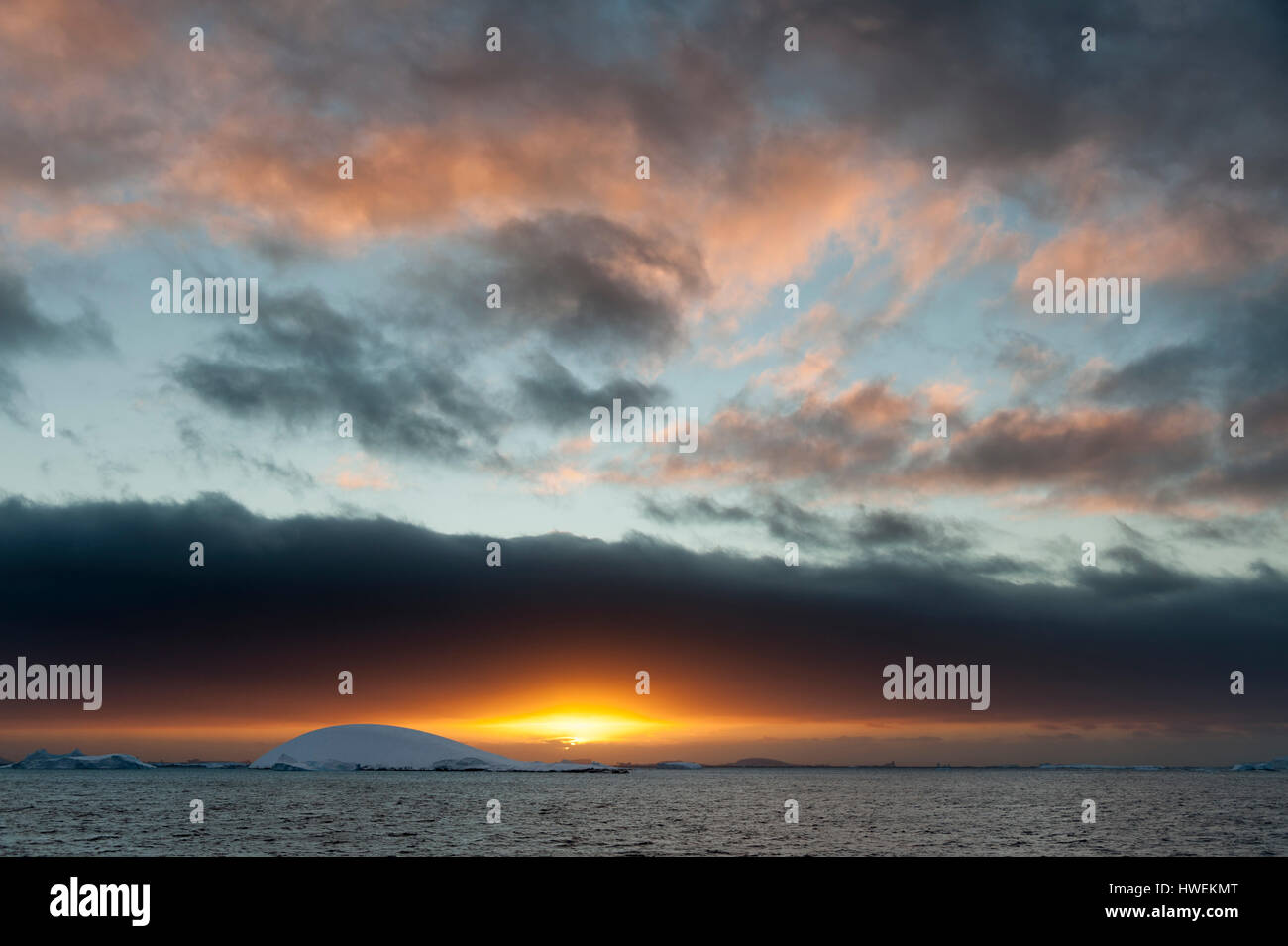 Sunset over icebergs in Lemaire channel, Antarctica Stock Photo