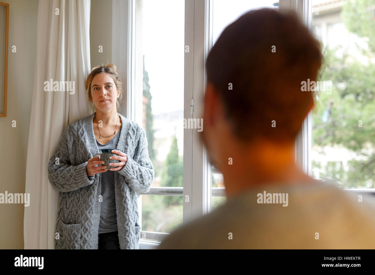 Mid adult couple at home, having disagreement - Stock Image