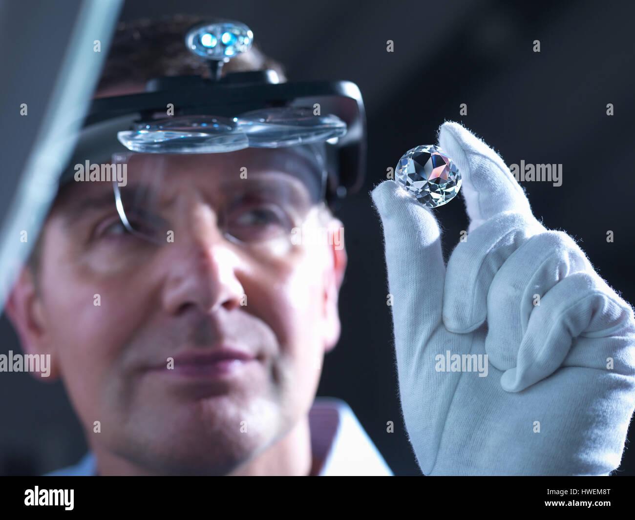 Jeweller inspecting replica diamonds - Stock Image
