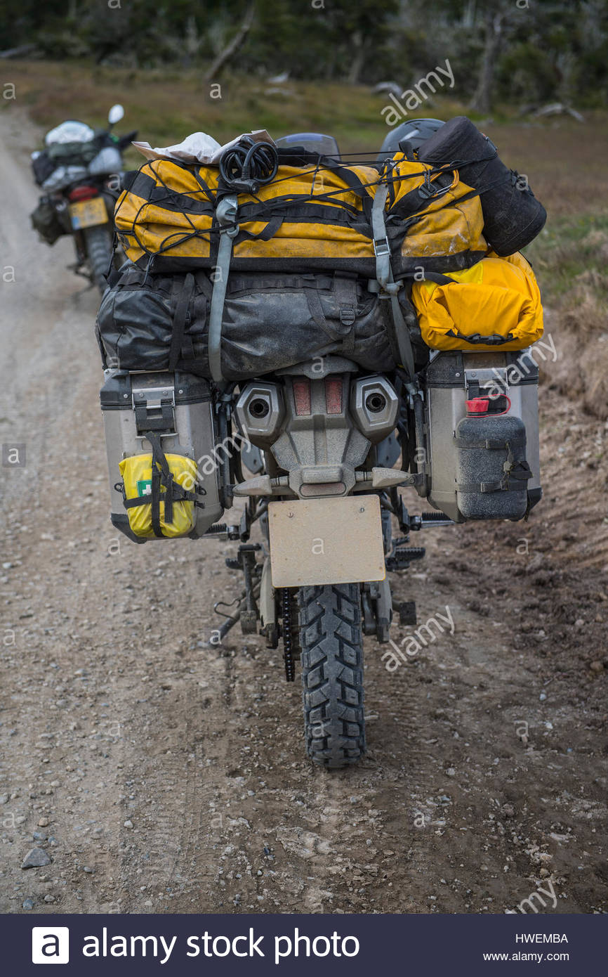 Heavily packed touring motorbike on dirt road, Tierra del Fuego, Argentina - Stock Image