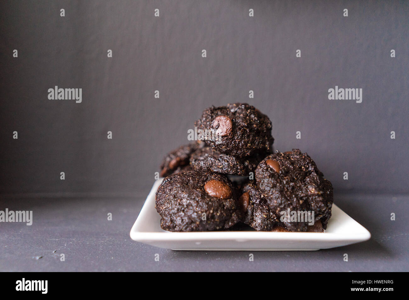 Stack of Vegan chocolate brownie cookie on white square plate Stock Photo
