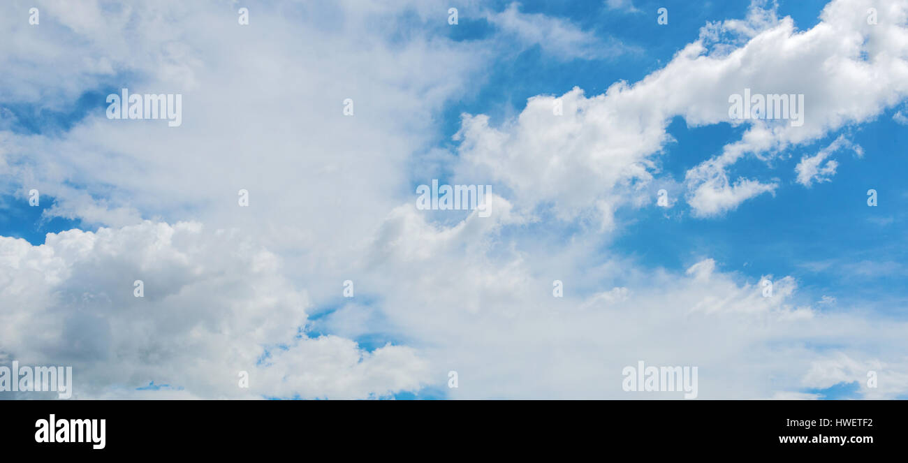 Wide Ground Level Shot Of White Clouds In Blue Daylight Sky Stock