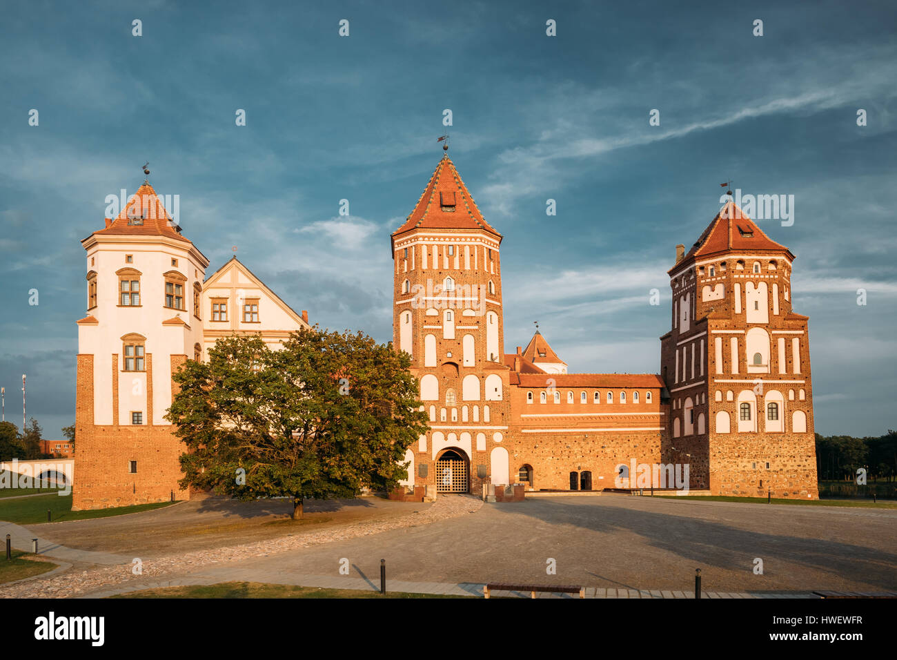 Mir, Belarus. Mir Castle Complex On Blue Sunny Sunset Sky Background. Architectural Ensemble Of Feudalism, Cultural - Stock Image