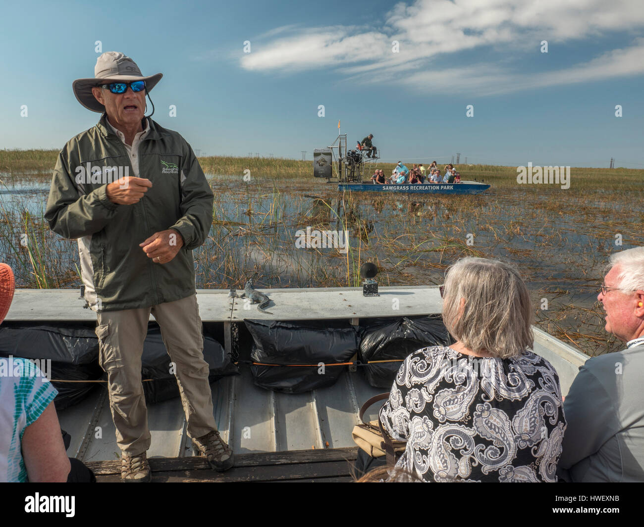 Tourist Enjoy An Airboat Ride At Sawgrass Recreation Park Hoping To See Wild Florida Everglades Alligators - Stock Image