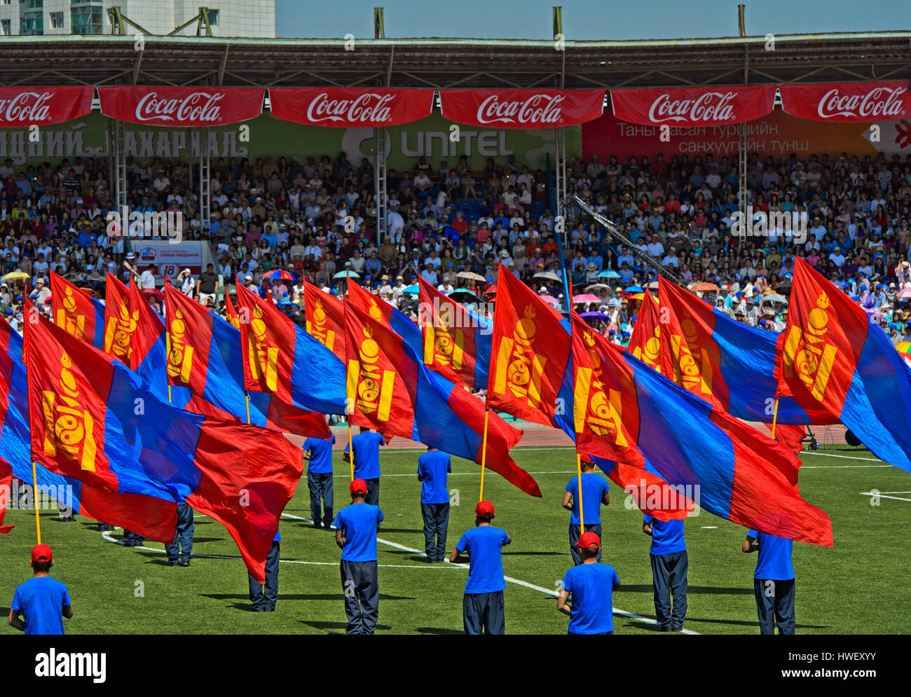 Standard bearers with the Mongolian national flag at the opening of the Naadam Festival, National Sports Stadium, - Stock Image