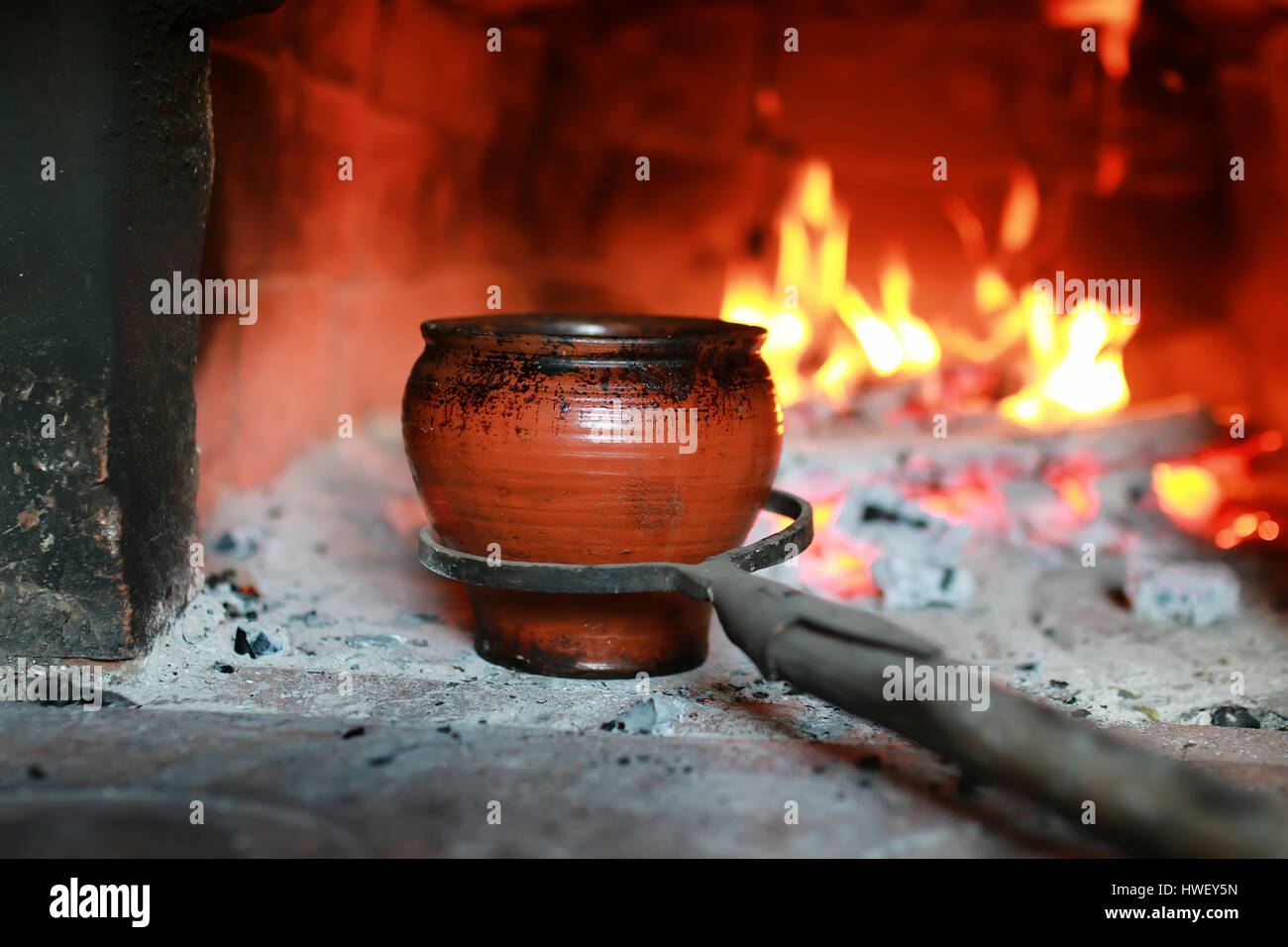pot in the oven with food the oven fork - Stock Image