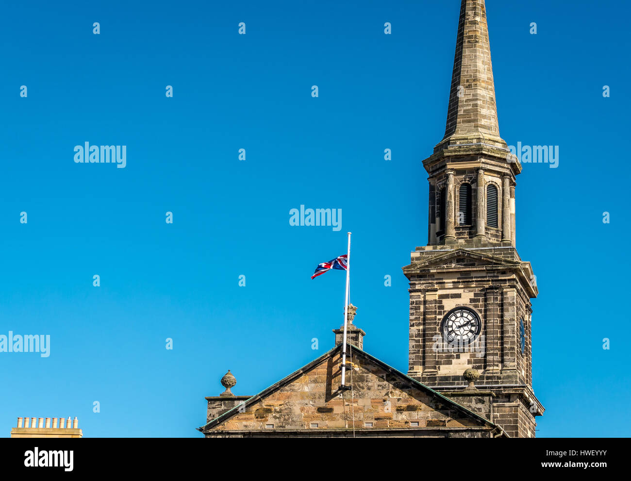 Haddington Town Hall with Union Jack and clock spire, East Lothian, Scotland, UK - Stock Image