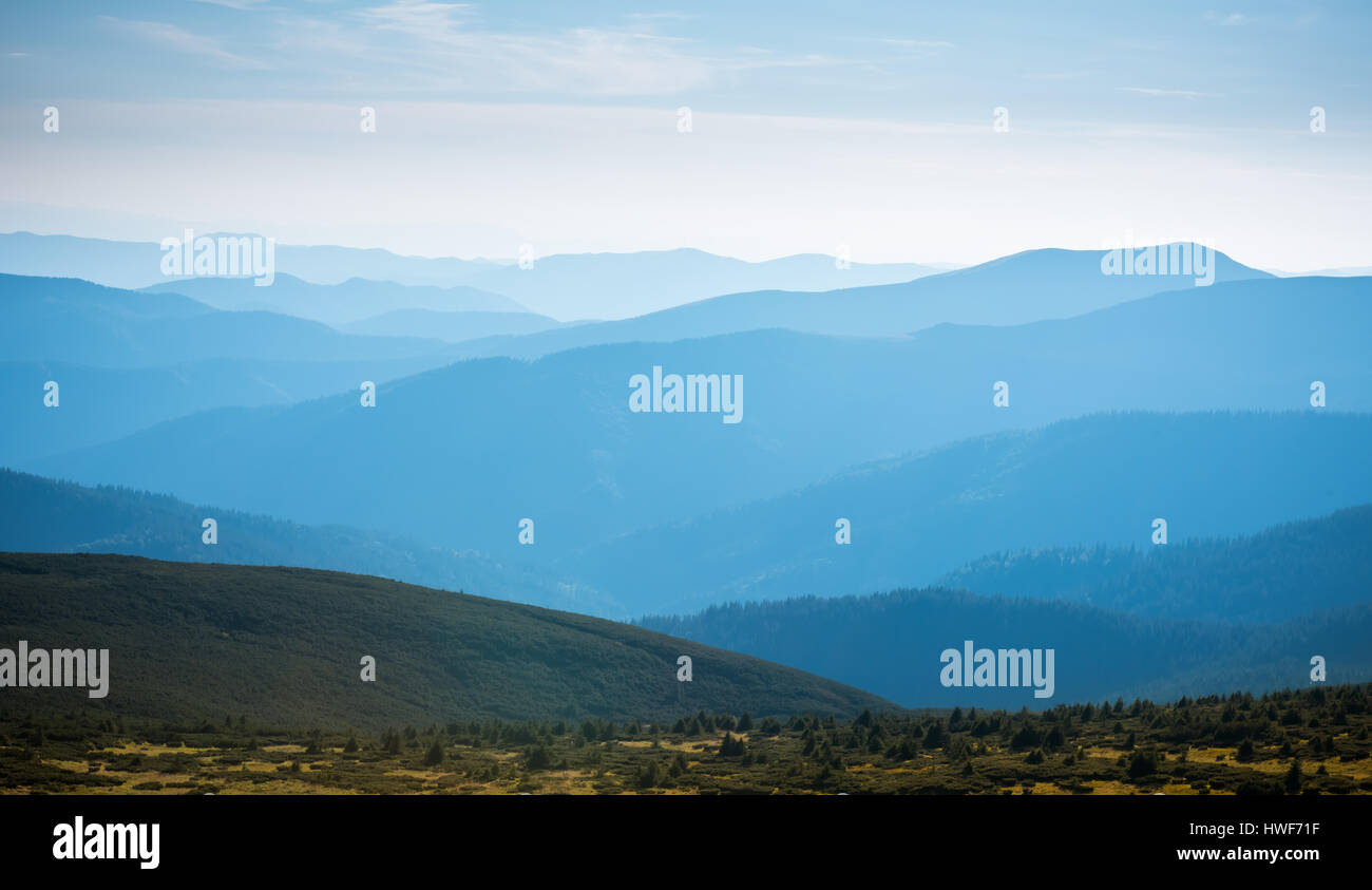 Layers of blue mountain, landscape view of Alps - Stock Image