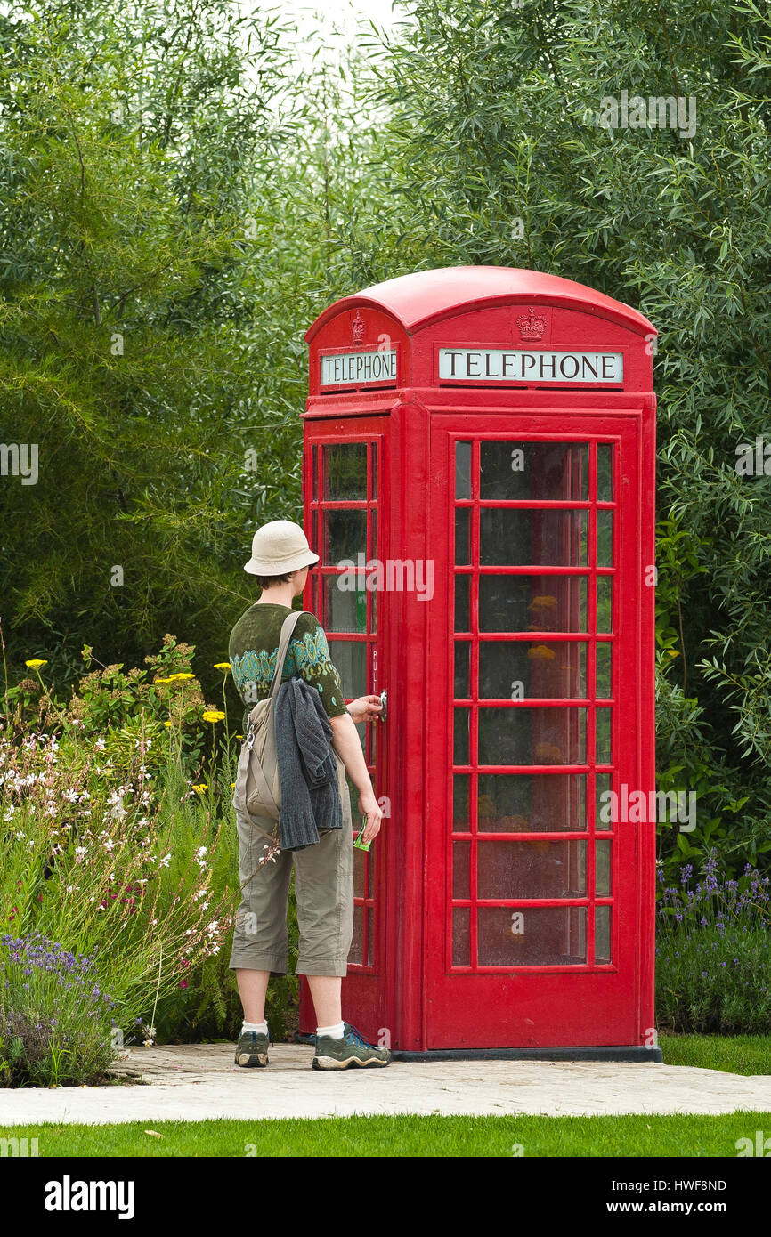 English telephone booth, France, Royan, Les Jardins du Monde (The Gardens of the World) - Stock Image