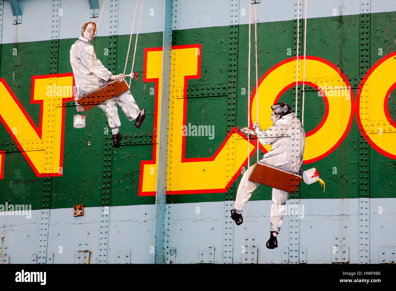 Mural depicting two painters painting Camden Lock on railway bridge Camden Town - Stock Image