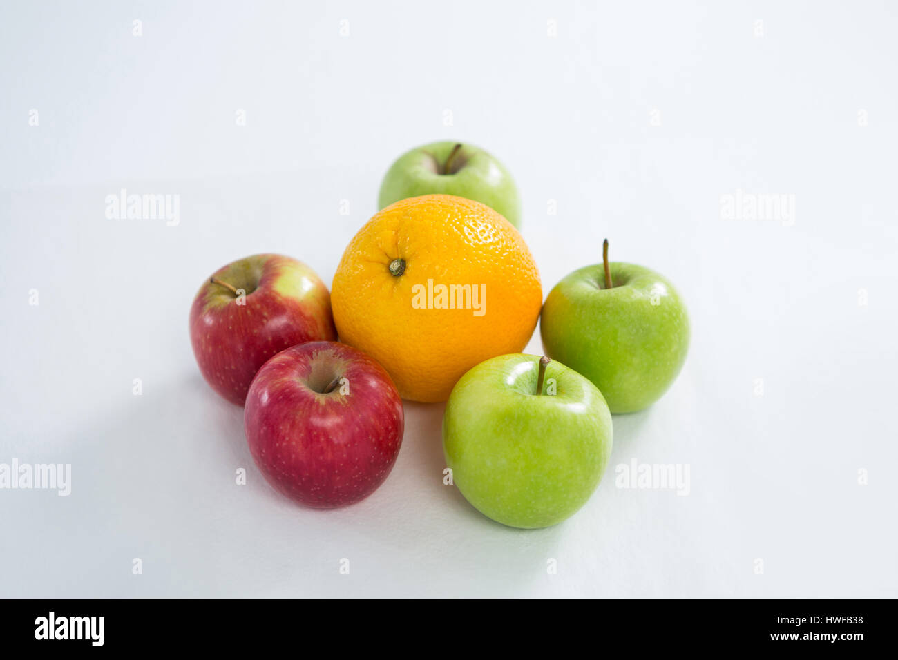 Close-up of oranges, red apples and green apples o white background - Stock Image