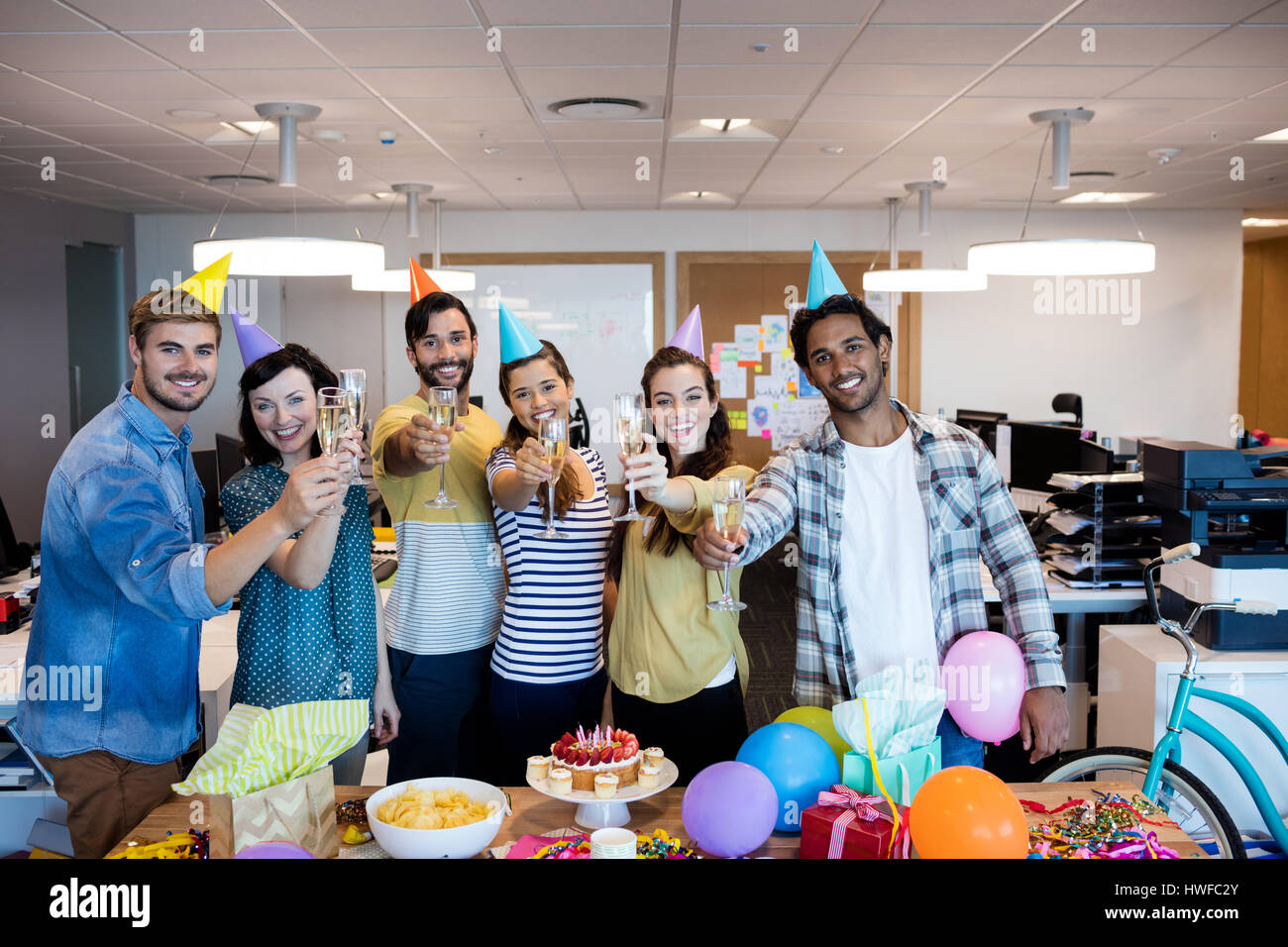 Creative business team having a toast on colleges birthday - Stock Image