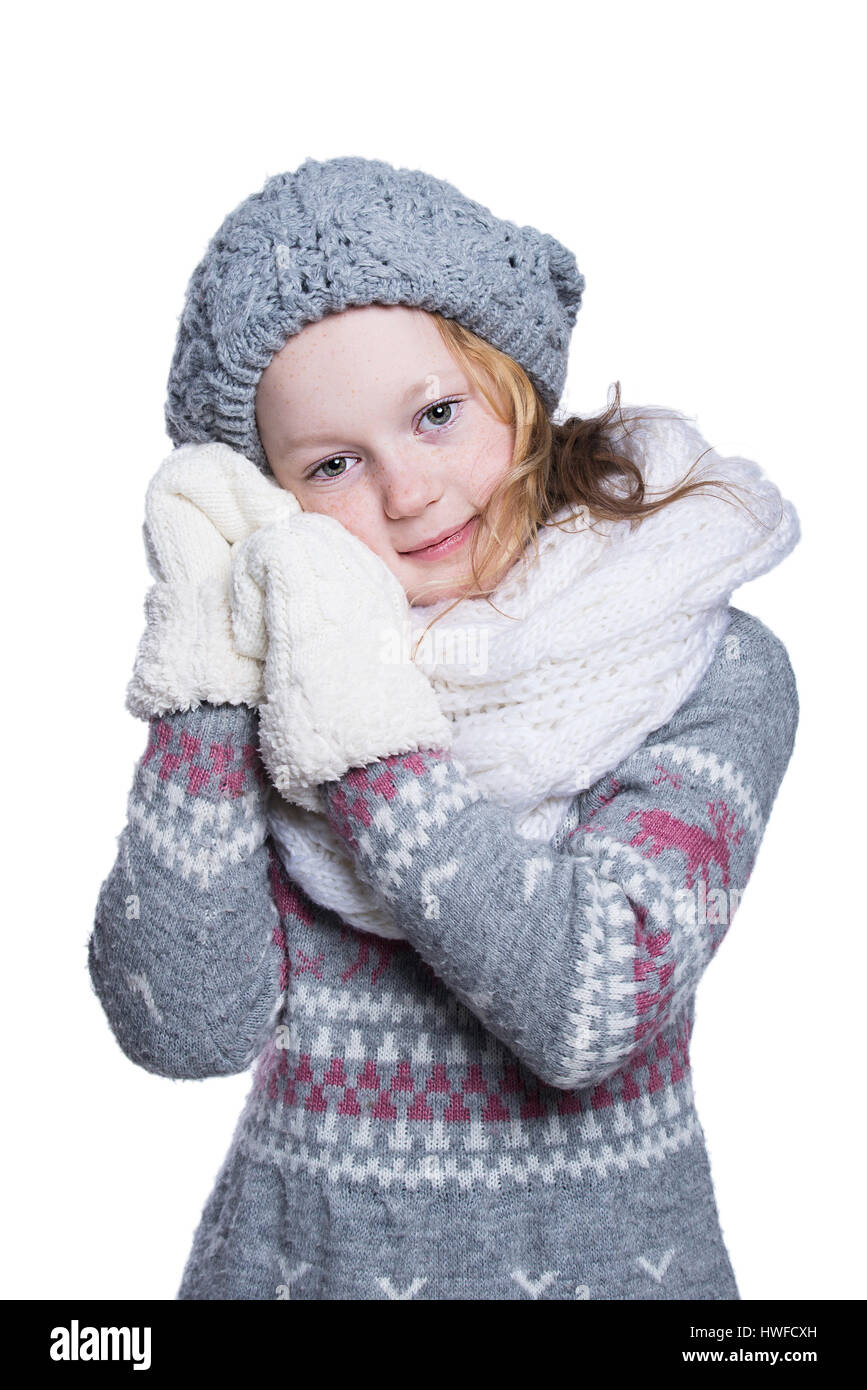 73497729eb789 Happy cute kid posing in the studio isolated on white background. Wearing  winter clothes.