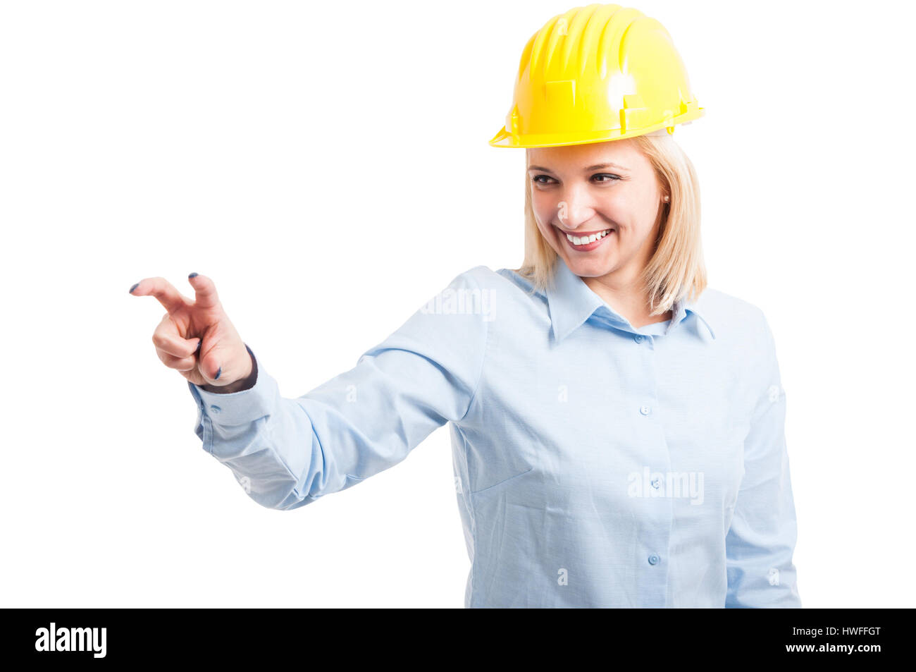 Female engineer wearing helmet using touchscreen copypsace isolated on white background - Stock Image