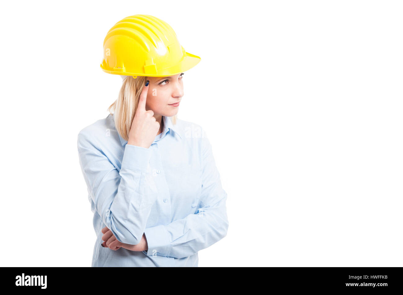 Portrait woman engineer making thinking gesture looking up isolated on white background with copy text space - Stock Image