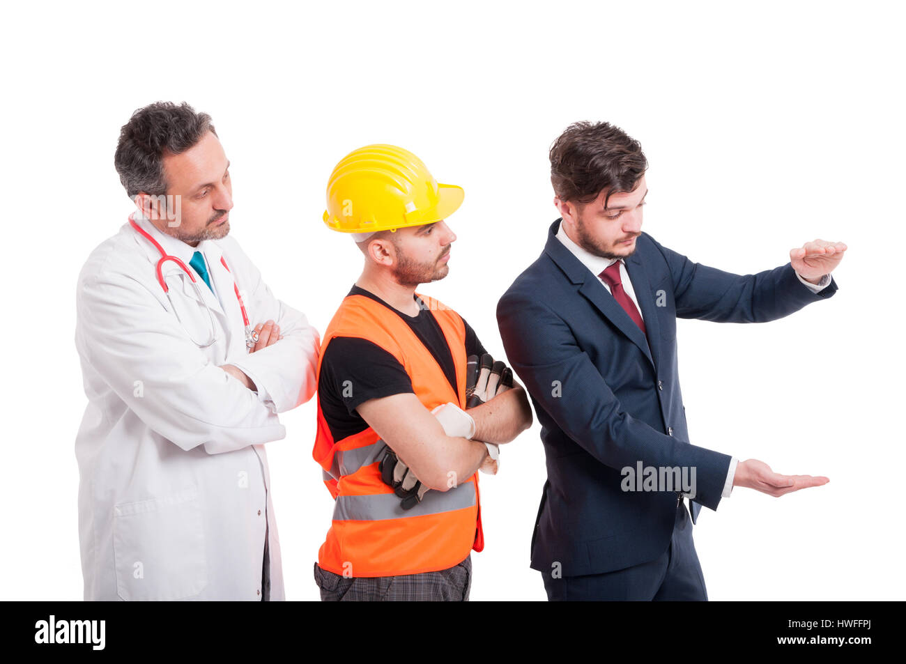 Businessman near medic and constructor holding something big in his hands with copyspace isolated on white Stock Photo