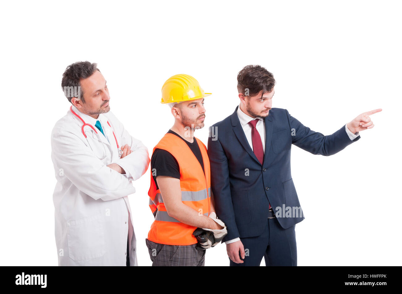 Men with different professions looking at something which businessman is pointing at isolated on white - Stock Image