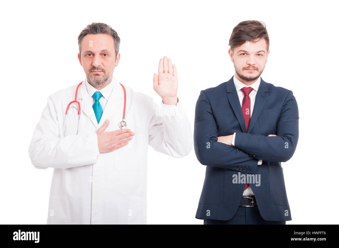 Honest male medic making a vow as devotion or loyalty concept near businessman isolated on white background - Stock Image