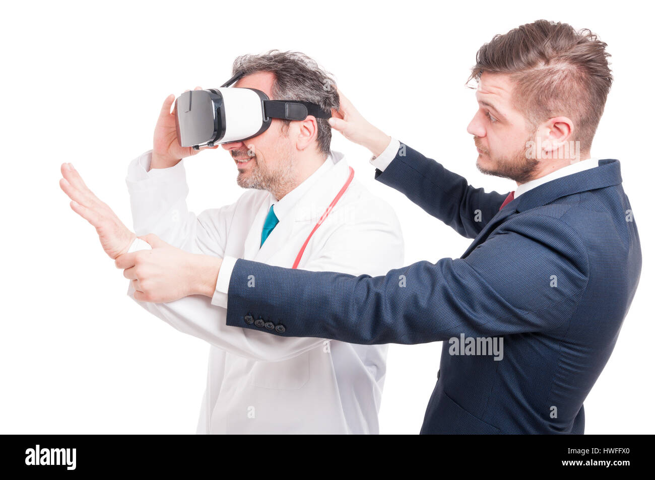 Handsome businessman with young medic looking through vr headset isolated on white Stock Photo