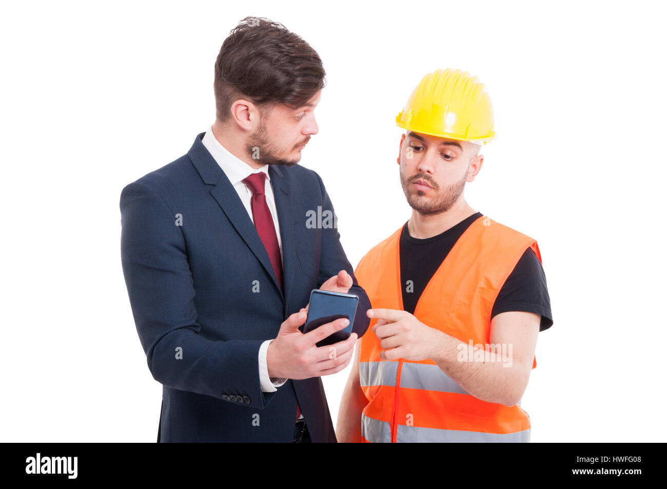 Young director showing something to constructor or engineer on the cellphone isolated on white - Stock Image