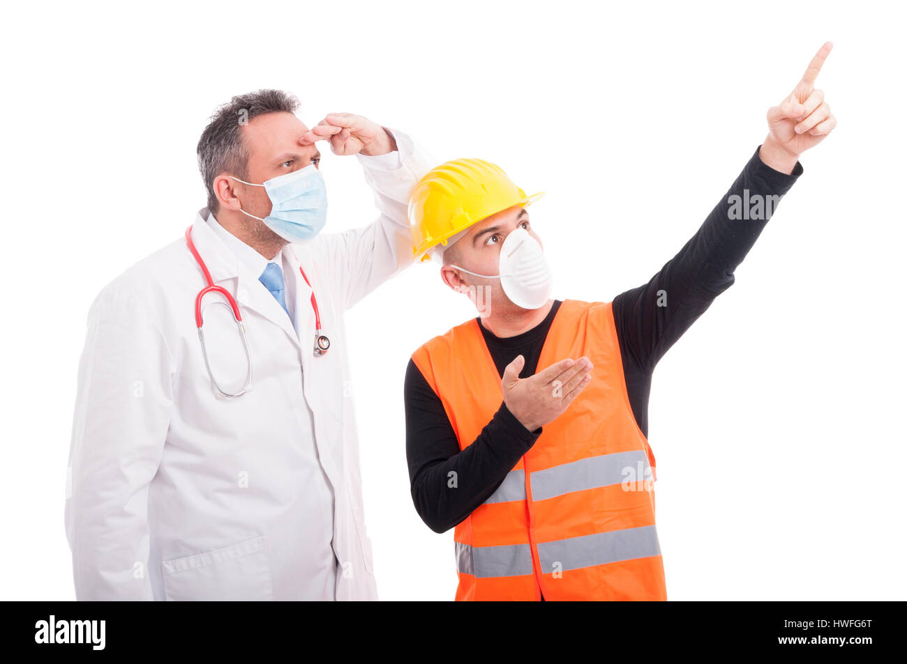 Constructor showing far away something at doctor isolated on white background Stock Photo