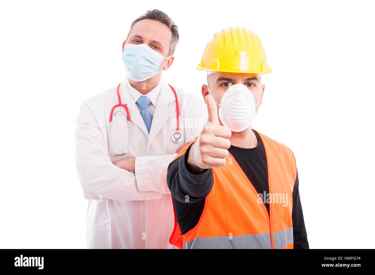Trustworthy constructor and doctor showing thumb up being confident isolated on white background - Stock Image