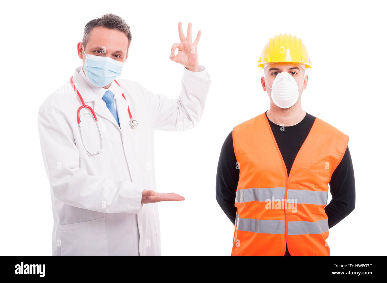 Doctor holding something and showing okay with constructor aside isolated on white background with copy text space - Stock Image