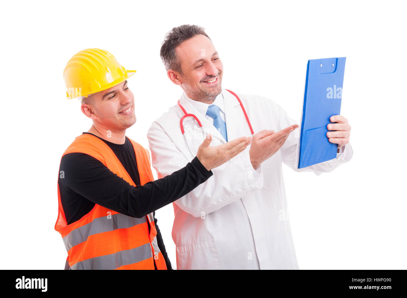 Doctor and constructor showing something on clipboard and smiling isolated on white background - Stock Image