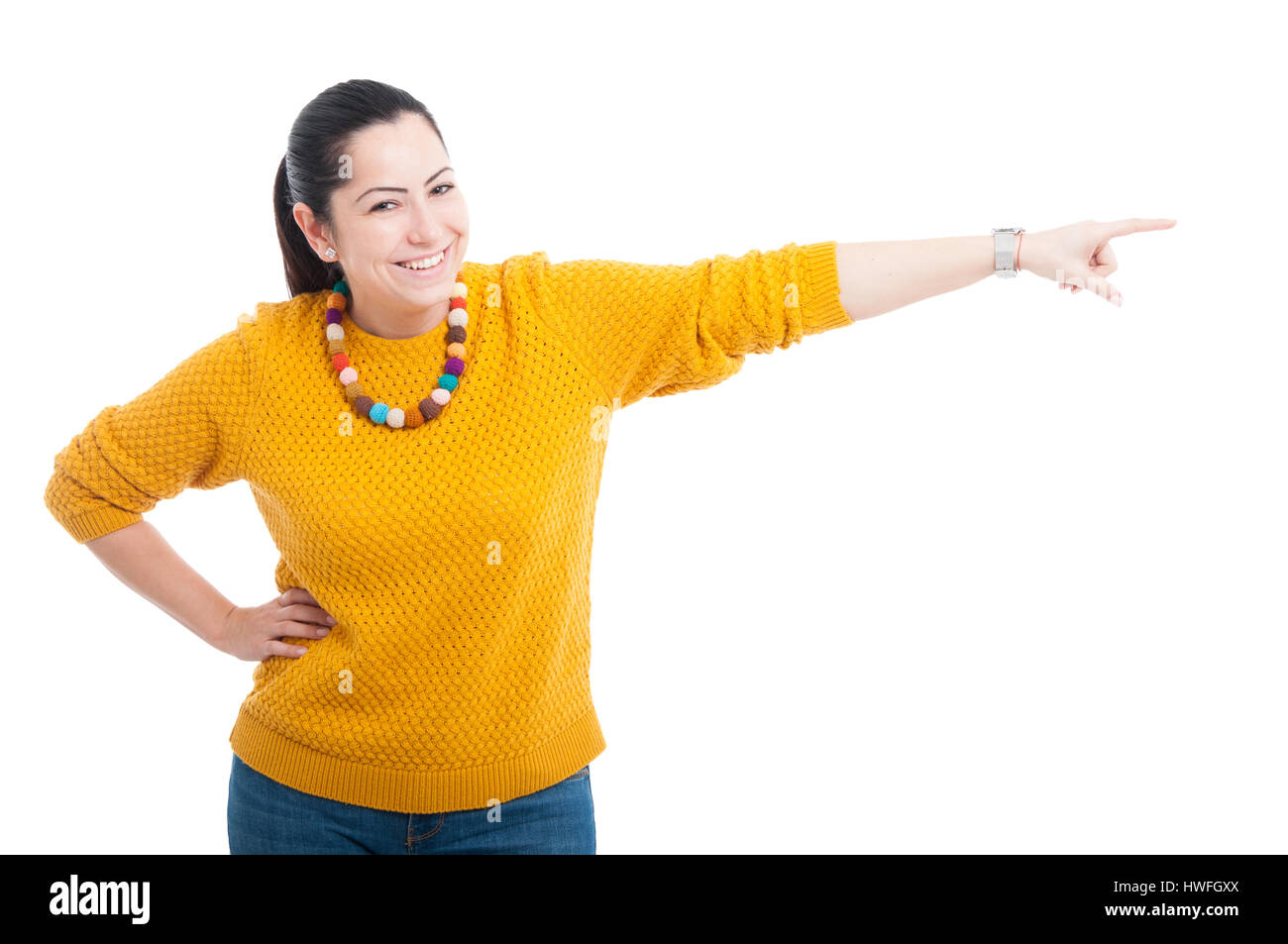 Happy female pointing or indicate something on the left side isolated on white - Stock Image
