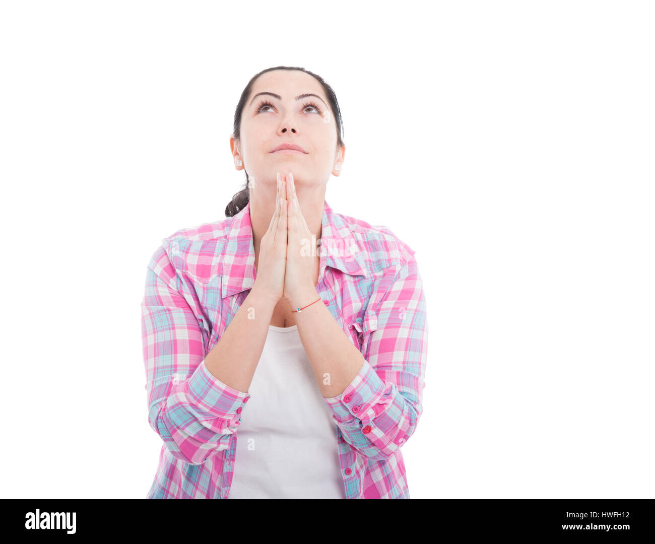 Beautiful lady praying for something with clasped hands isolated on white - Stock Image