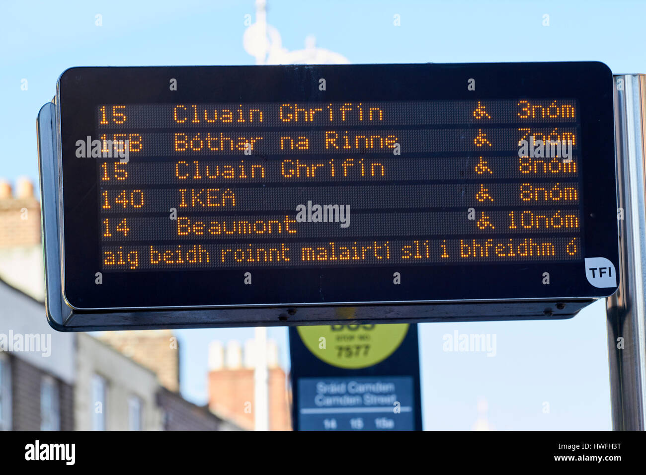 electronic sign with bus information in irish and times at city centre bus stop Dublin Republic of Ireland Stock Photo